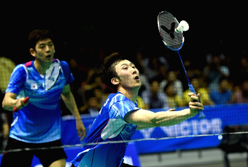Yong Dae Lee (L) and Yeon Seong Yoo of South Korea compete during the men's doubles final of Dong Feng Citroen Badminton Asia Championships 2015 in Wuhan, China, on ...