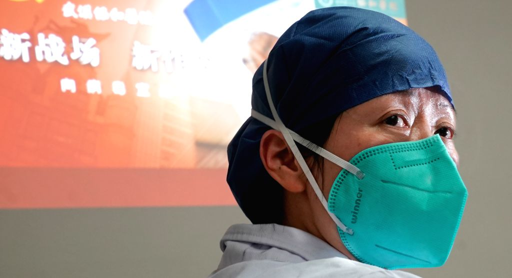 WUHAN, Jan. 23, 2020 (Xinhua) -- Photo taken on Jan. 22, 2020 shows Zhou Qiong, a doctor of department of respiratory medicine at Union Hospital affiliated to Tongji Medical College of Huazhong University of Science and Technology, who is a member of