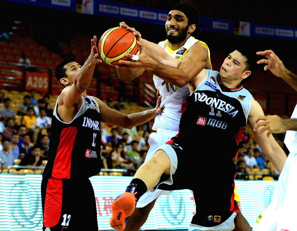 India's Amritpal Singh (C) fights for the ball during the match between India and Indonesia in the 5th FIBA Asia Cup basketball tournament in Wuhan, capital of ... - Amritpal Singh