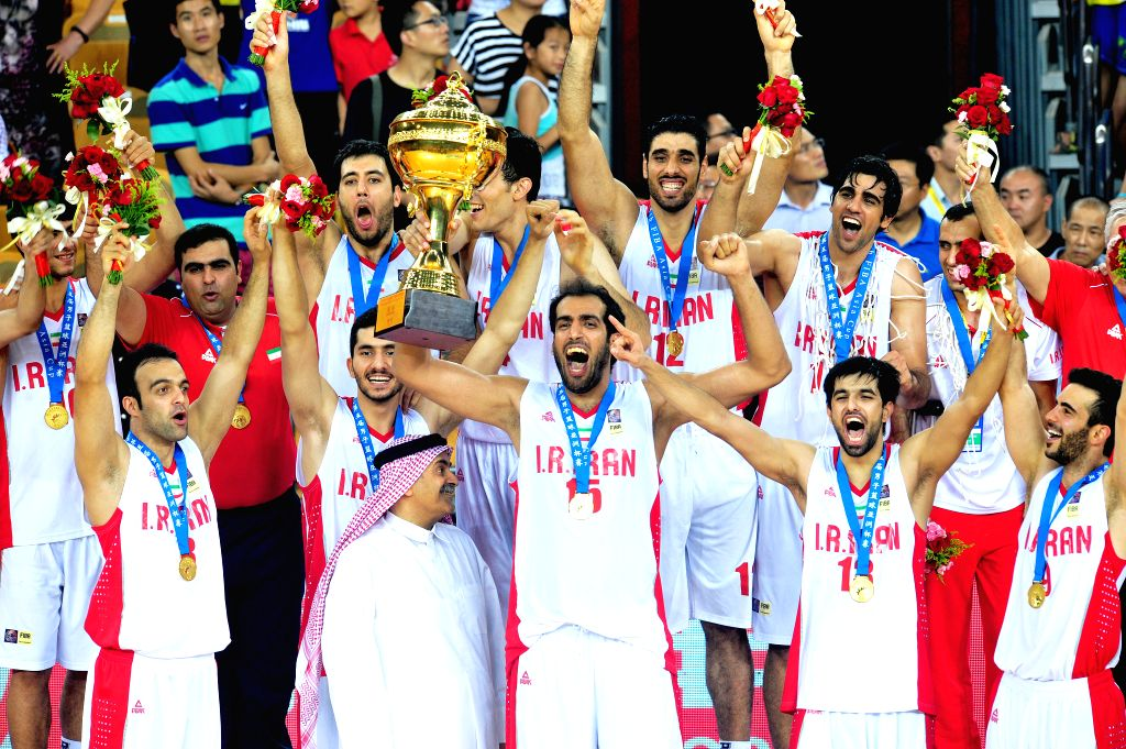 Players of Iran celebrate victory during the awarding ceremony after the final match against Chinese Taipei in the 5th FIBA Asia Cup basketball tournament in Wuhan, ..
