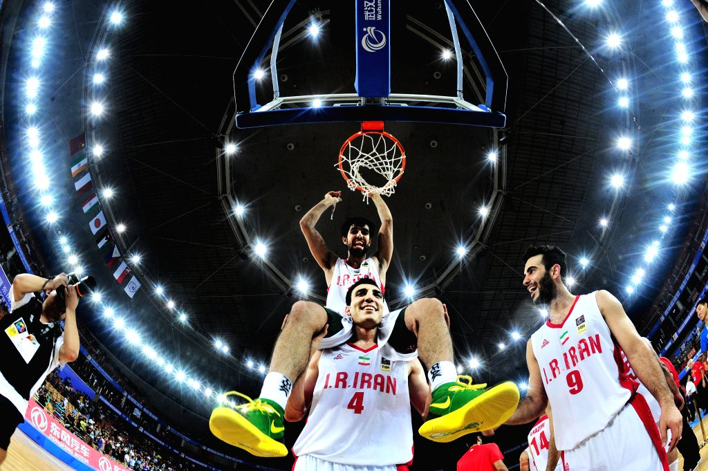 Players of Iran celebrate victory after the final match against Chinese Taipei in the 5th FIBA Asia Cup basketball tournament in Wuhan, capital of central China's ...