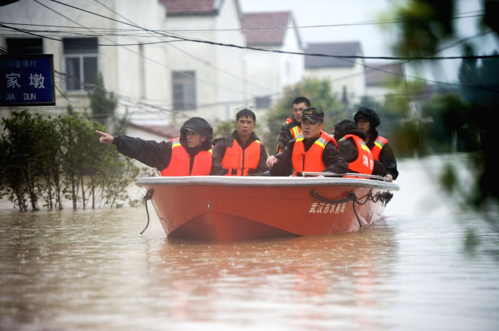 WUHAN, July 2, 2016 - Rescuers search for trapped villagers after a dike breach in Xinzhou District of Wuhan, central China's Hubei Province, July 2, 2016. Heavy rainfall caused a dike breach on the ...