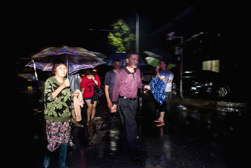 WUHAN, July 6, 2016 - Victims prepare to take bus to safe place in flood-hit Xiaosi Township of Wuhan City, capital of central China's Hubei Province, July 6, 2016. Torrential rains of up to 382.2 ...