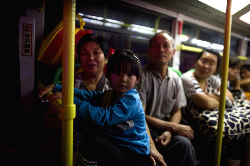 WUHAN, July 6, 2016 - Victims take bus to safe place in flood-hit Xiaosi Township of Wuhan City, capital of central China's Hubei Province, July 6, 2016. Torrential rains of up to 382.2 millimeter ...