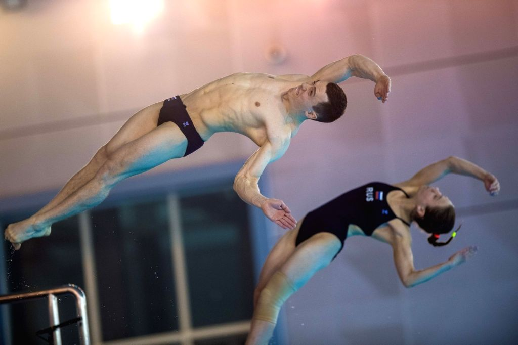 WUHAN, June 4, 2018 - Vakeriia Belova and Sergey Nazin (L) of Russia compete during the mix doubles 10m platform final at the FINA Diving World Cup 2018 in Wuhan, central China's Hubei Province, on ...