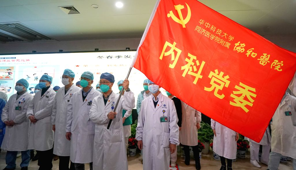 "Wuhan: Medical staff of Union Hospital affiliated to Tongji Medical College of Huazhong University of Science and Technology attend a ceremony to form a ""assault team"" in the fight against the pneumonia caused by the novel coronavirus in Wuhan, centr"