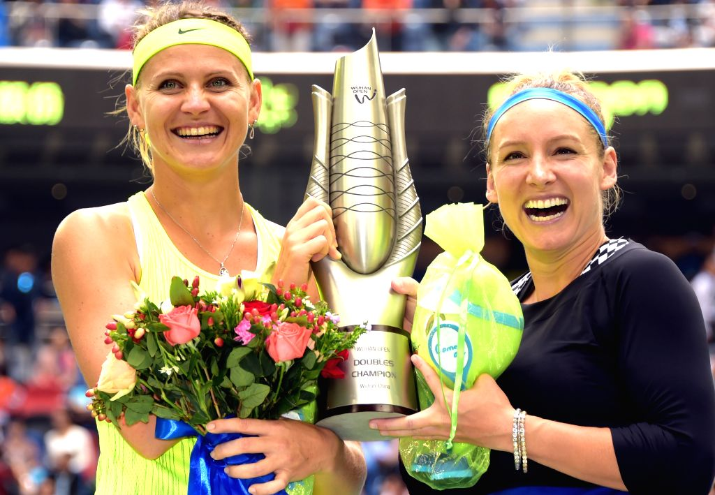 WUHAN, Oct. 1, 2016 - Bethanie Mattek-Sands (R) of the United States and her partner Lucie Safarova of the Czech Republic pose with the champion trophy during the awarding ceremony for the women's ... - Sania Mirza