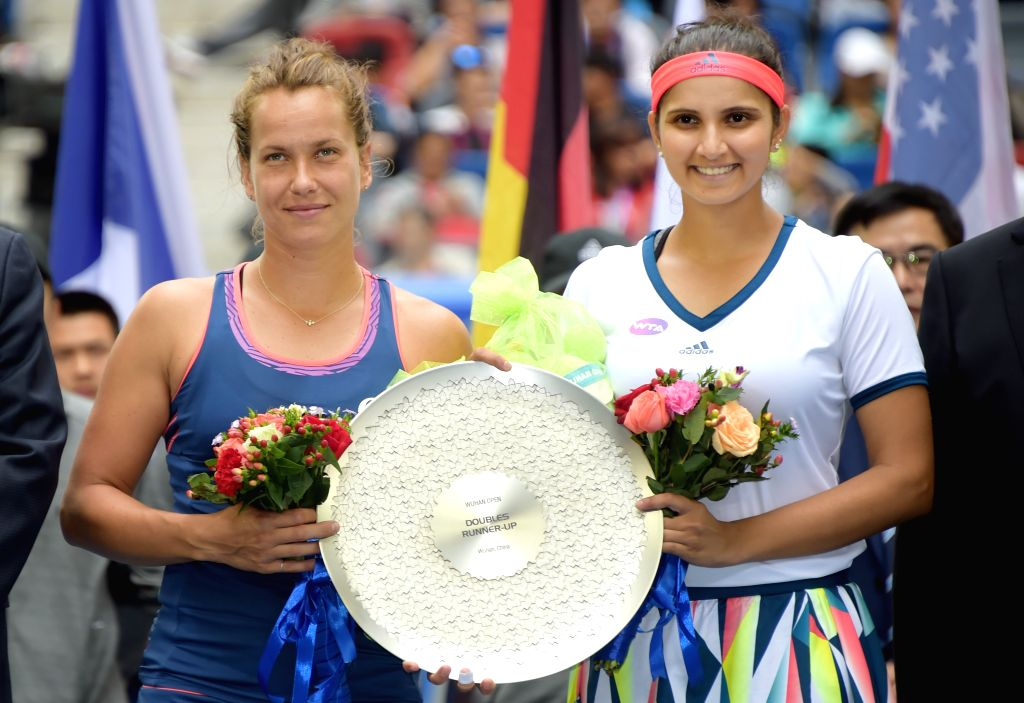 WUHAN, Oct. 1, 2016 - Sania Mirza (R) of India and Barbora Strycova of the Czech Republic pose for a photo during the awarding ceremony for the women's doubles final at the WTA Wuhan Open tennis ... - Sania Mirza