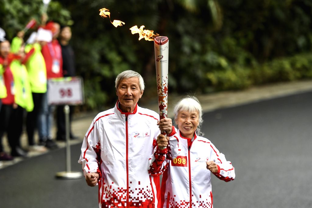 WUHAN, Oct. 16, 2019 - Torchbearer Ma Xu (R) and her husband participate in the 7th International Military Sports Council (CISM) Military World Games Torch Relay in Wuhan, capital of central China's ...