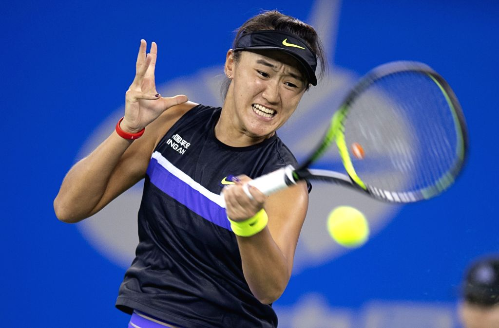 WUHAN, Sept. 22, 2019 - Wang Xiyu of China returns a shot during the women's singles first round match between Wang Xiyu of China and Barbora Strycova of the Czech Republic at the 2019 WTA Wuhan Open ...