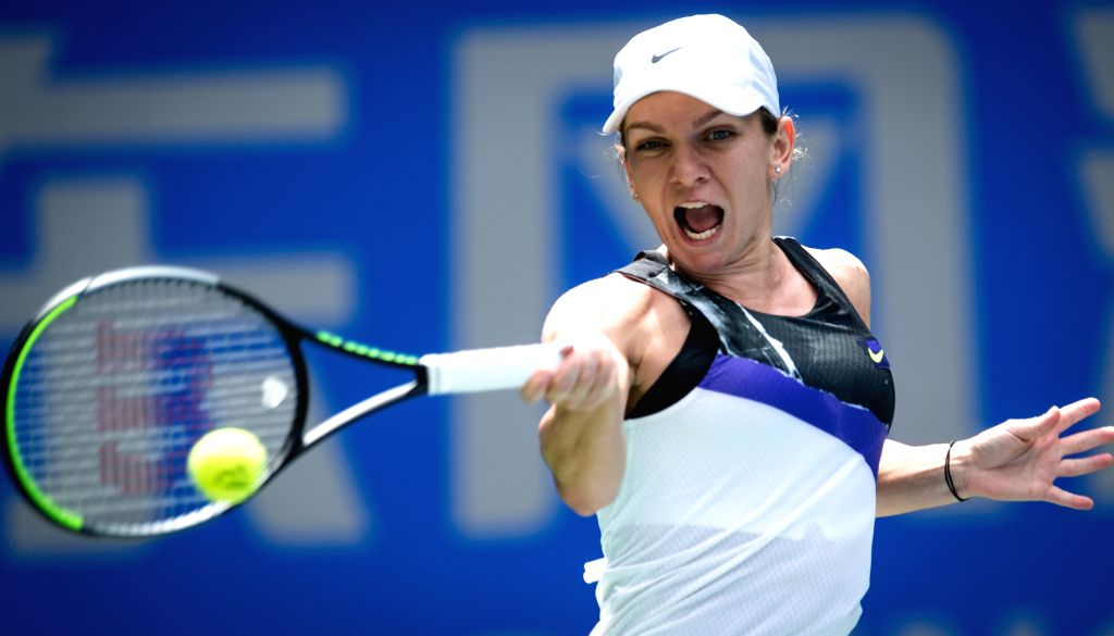 WUHAN, Sept. 24, 2019 (Xinhua) -- Simona Halep of Romania returns a shot during the women's singles second round match between Simona Halep and Barbora Strycova at the 2019 WTA Wuhan Open tennis tournament in Wuhan, central China's Hubei Province, Se