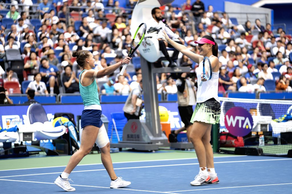 WUHAN, Sept. 27, 2019 - Duan Yingying (R) of China and Veronika Kudermetova of Russia celebrate after the women's doubles semifinal between Duan Yingying of China/Veronika Kudermetova of Russia and ...