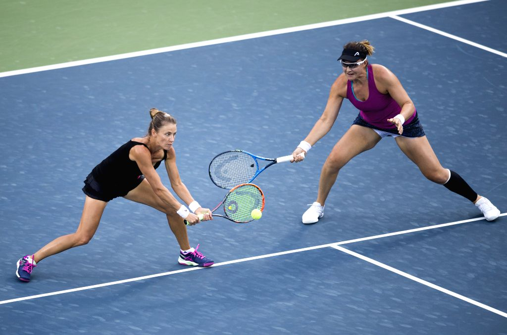 WUHAN, Sept. 28, 2017 - Alicja Rosolska (L) of Poland and Abigail Spears of the United States return the ball during the doubles quarterfinal match against Peng Shuai of China and Sania Mirza of ... - Sania Mirza
