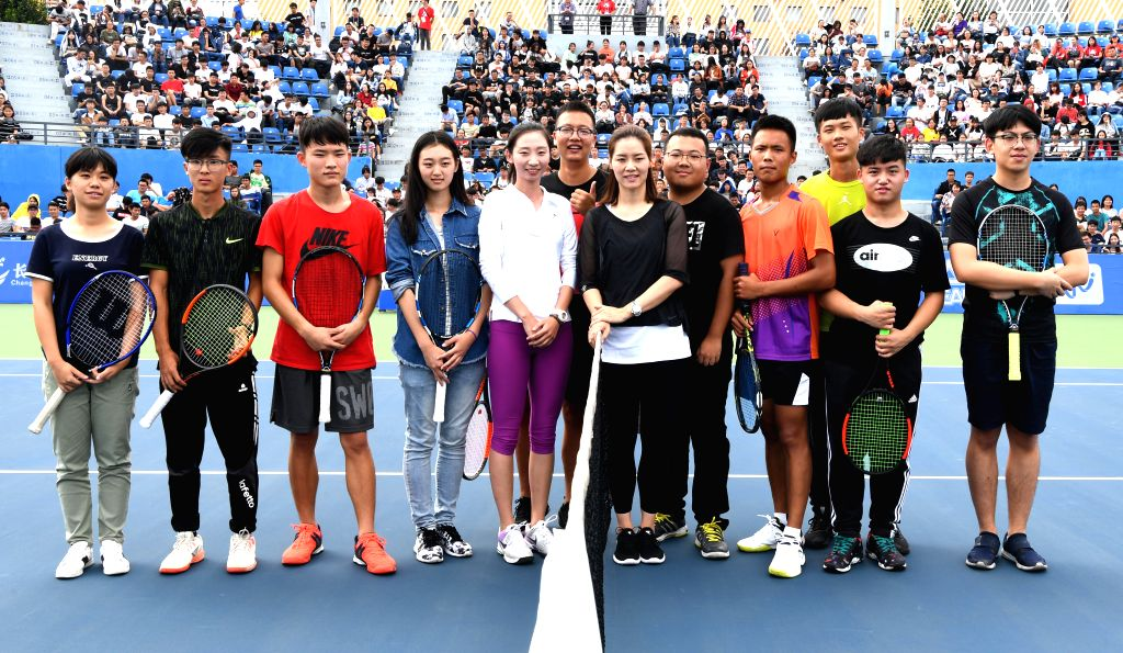 WUHAN,  Sept. 28,  2017 - Chinese two-time Grand Slam champion Li Na (6th R) takes photo with young tennis players during the 2017 WTA Wuhan Open Project event in Wuhan, capital of central China's ...