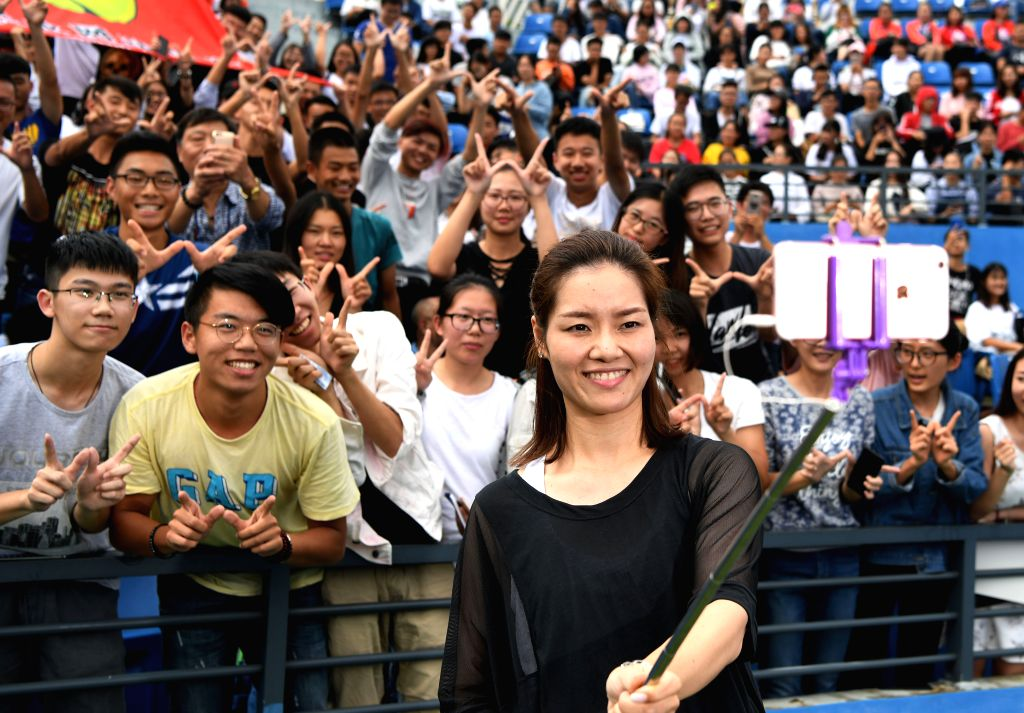 WUHAN,  Sept. 28,  2017 - Chinese two-time Grand Slam champion Li Na (front) takes selfie with young tennis players during the 2017 WTA Wuhan Open Project event in Wuhan, capital of central China's ...