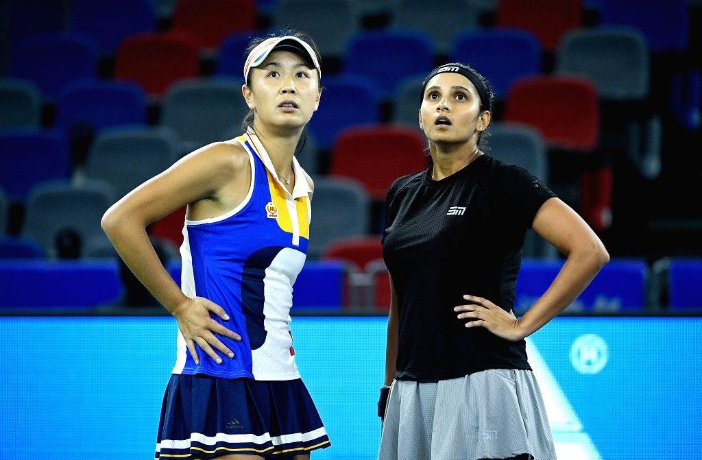 WUHAN, Sept. 29, 2017 - Peng Shuai (L) of China and Sania Mirza of India react during the doubles semifinal match against Chan Yung-Jan of Chinese Taipei and Martina Hingis of Switzerland at 2017 WTA ... - Sania Mirza and Martina Hingis