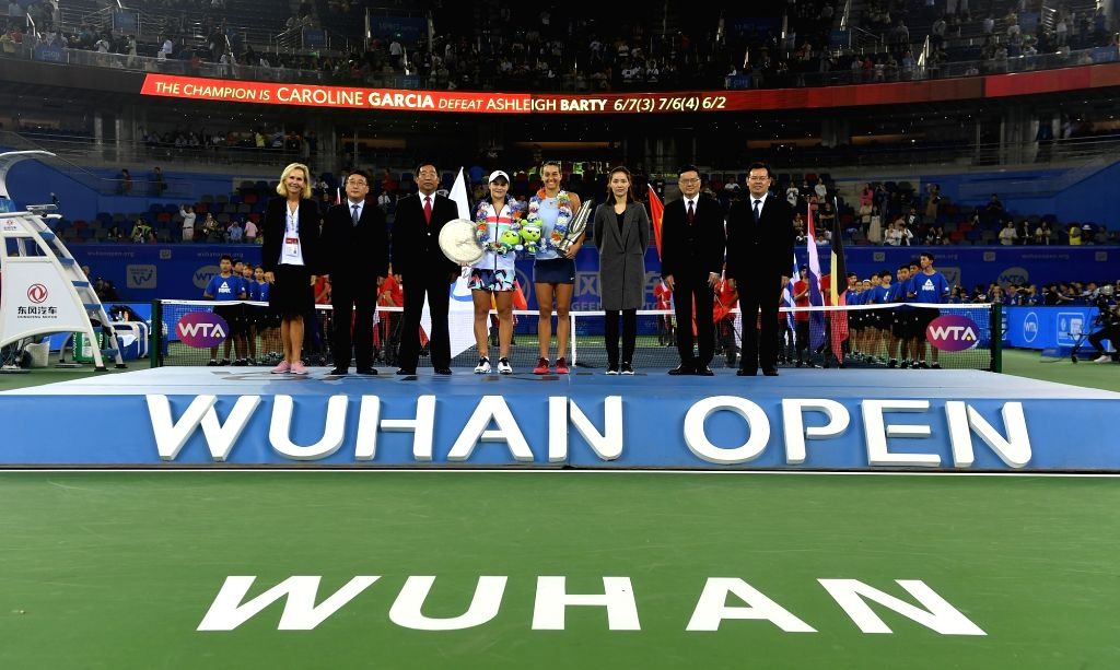 WUHAN, Sept. 30, 2017 - Caroline Garcia (4th R)of France and Ashleigh Barty of Australia (4th L) pose with guests on the awarding ceremony after the singles final match at 2017 WTA Wuhan Open in ...