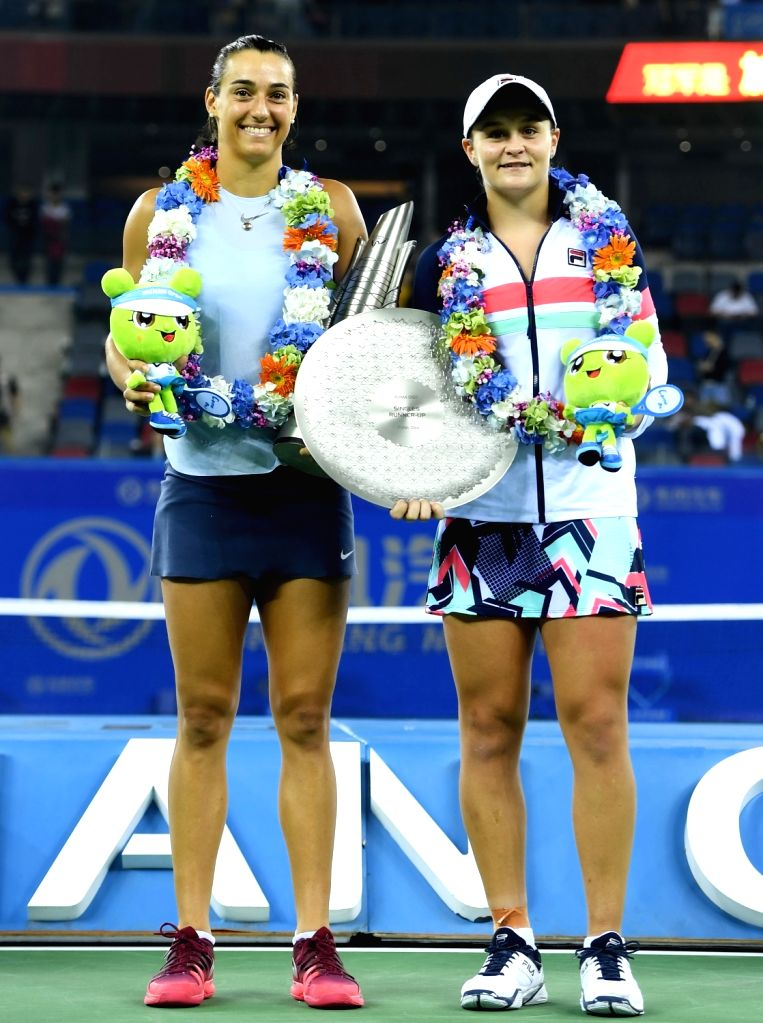 WUHAN, Sept. 30, 2017 - Caroline Garcia (L) of France and Ashleigh Barty of Australia pose on the awarding ceremony after their singles final match at 2017 WTA Wuhan Open in Wuhan, capital of central ...