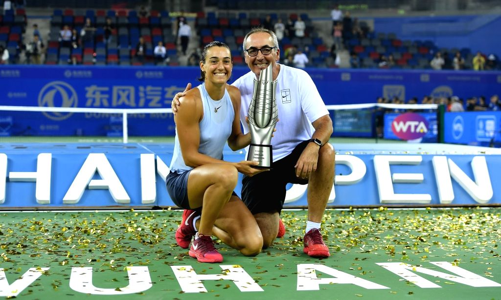 WUHAN, Sept. 30, 2017 - Caroline Garcia of France poses with her coach on the awarding ceremony after winning the singles final match against Ashleigh Barty of Australia at 2017 WTA Wuhan Open in ...