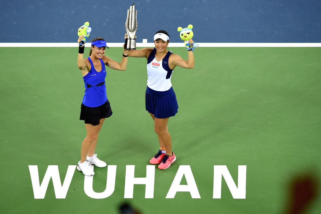 WUHAN, Sept. 30, 2017 - Martina Hingis (L) of Switzerland and Chan Yung-Jan of Chinese Taipei pose with the trophy on the awarding ceremony after the doubles final match against Yang Zhaoxuan of ... - Martina Hingis