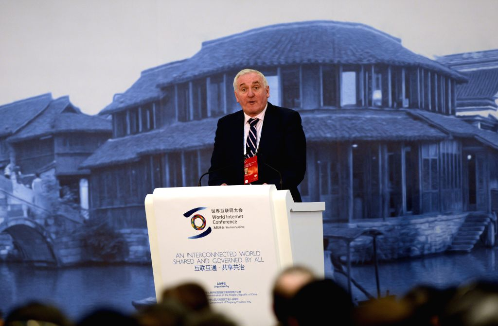 Wuzhen (China): Former Irish Prime Minister Bertie Ahern speaks at the opening ceremony of the 2014 World Internet Conference in Wuzhen, east China's Zhejiang Province, Nov. 19, 2014. Representatives - Bertie Ahern