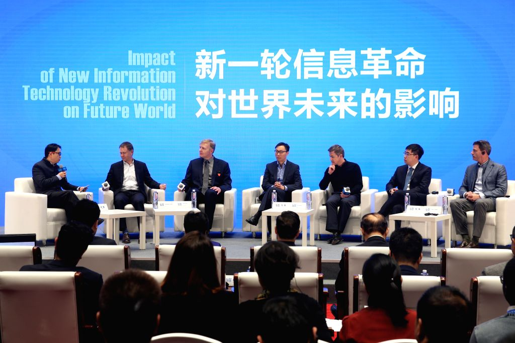 WUZHEN, Dec. 5, 2017 - Guests discuss during the forum of Business ers Dialogue: New Economy in the Internet Era of the 4th World Internet Conference in Wuzhen Town, east China's Zhejiang ...