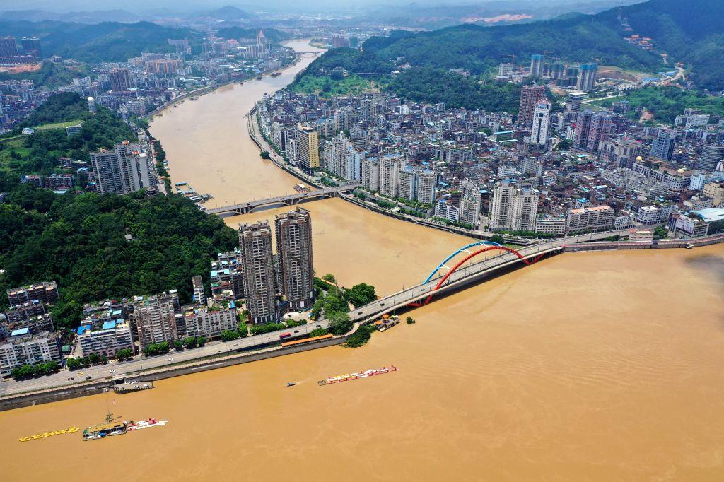 WUZHOU, July 16, 2019 - Aerial photo taken on July 16, 2019 shows flood passing through Wuzhou, south China's Guangxi Zhuang Autonomous Region. The water level at Wuzhou hydrological station of the ...