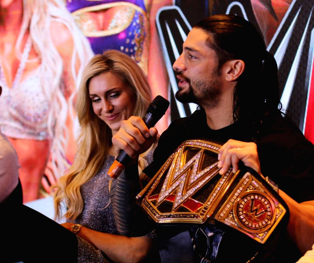 WWE Divas Champion Charlotte and World Heavyweight Champion Roman Reigns during during a press conference in New Delhi, on Jan 14, 2016.
