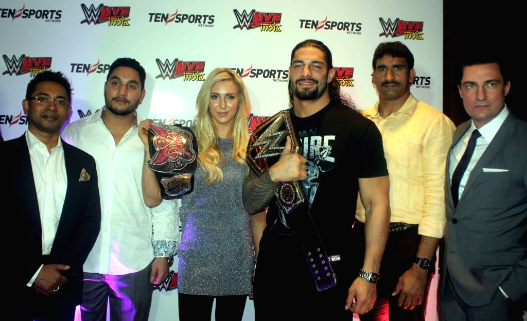 WWE NXT Superstar Lovepreet Sangha, Divas Champion Charlotte, World Heavyweight Champion Roman Reigns and NXT Superstar Satender Ved Pal  during during a press conference in New Delhi, on ...