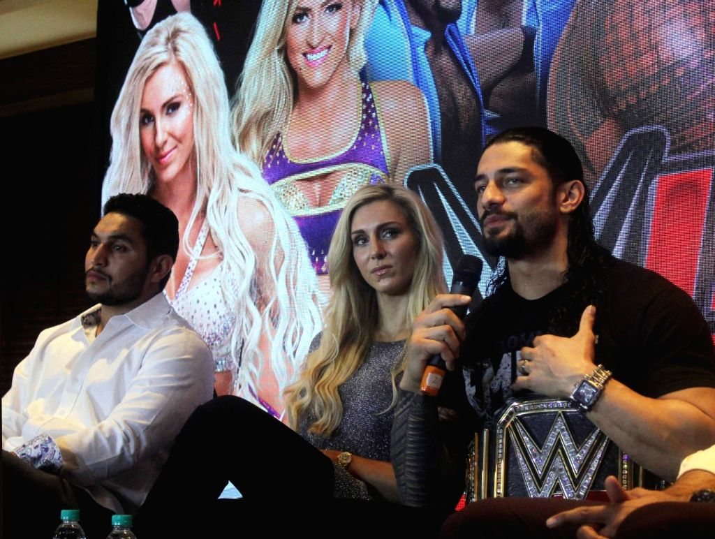WWE NXT Superstar Lovepreet Sangha, Divas Champion Charlotte and World Heavyweight Champion Roman Reigns during during a press conference in New Delhi, on Jan 14, 2016.