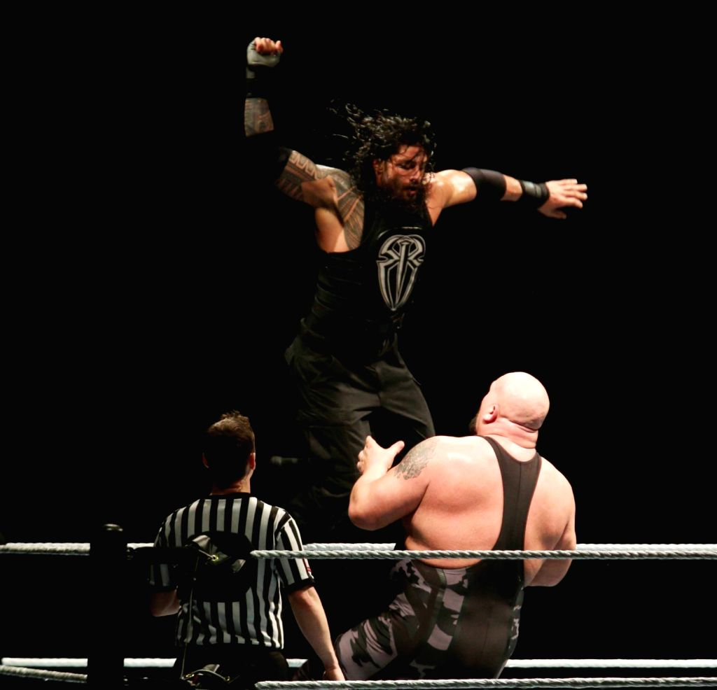 WWE wrestlers Big Show and Roman Reigns in action during a WWE event at the Indira Gandhi Stadium in New Delhi, on Jan 15, 2016. - Indira Gandhi Stadium