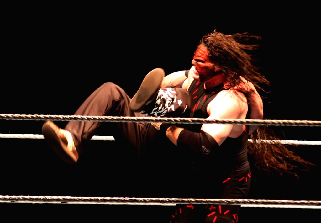 WWE wrestlers Kane and Bray Wyatt in action during a WWE event at the Indira Gandhi Stadium in New Delhi, on Jan 15, 2016. - Indira Gandhi Stadium