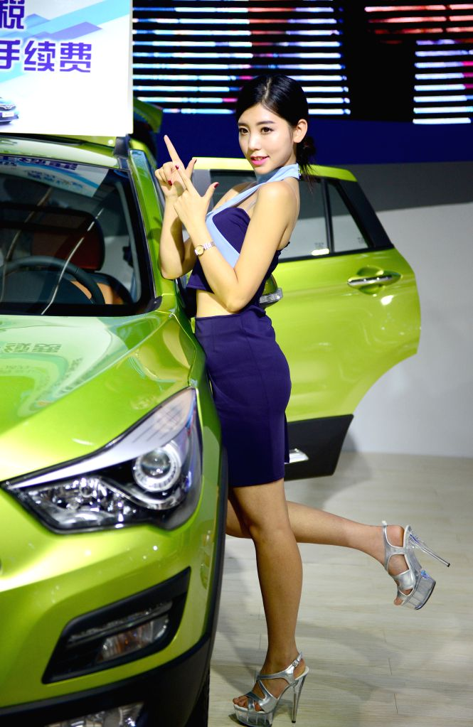 XI'A model is seen at the 7th International Auto Exhibition 2016 in Xi'an, capital of northwest China's Shaanxi Province, July 6, 2016. The auto exhibition, with the ...