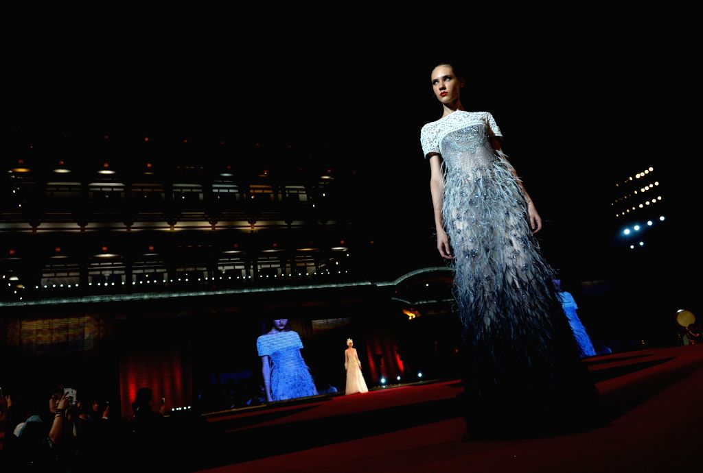 XI'A model presents a creation during a fashion show of a top Italian brand at the Tang Paradise in Xi'an, capital of northwest China's Shaanxi Province, Sept. 4, 2014. .