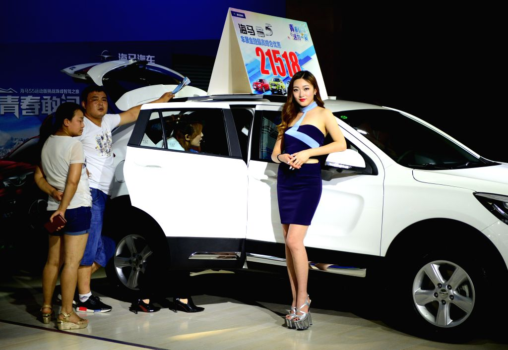 XI'People visit a type of Haima car at the 7th International Auto Exhibition 2016 in Xi'an, capital of northwest China's Shaanxi Province, July 6, 2016. The auto ...