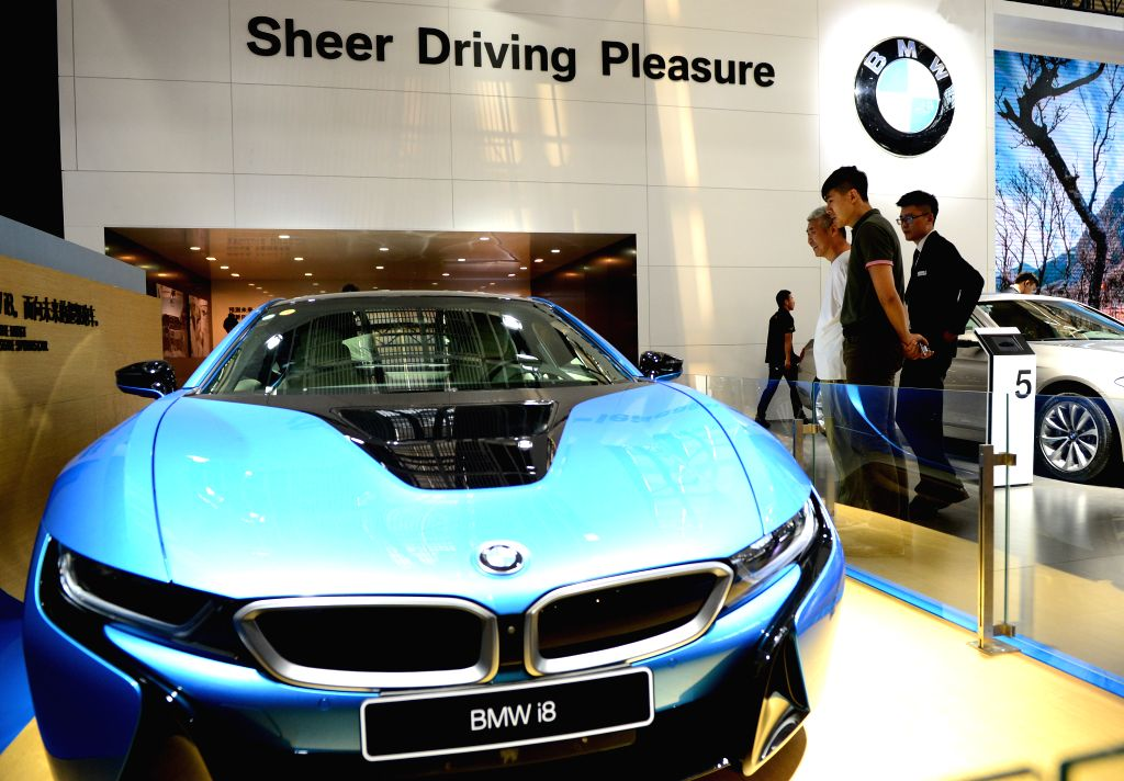 XI'People visit the displayed BMW i8 sports car at the 7th International Auto Exhibition 2016 in Xi'an, capital of northwest China's Shaanxi Province, July 6, 2016. The ...