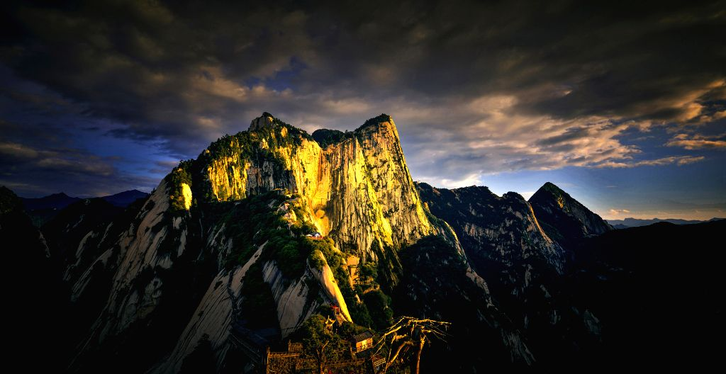 XI'Photo taken on July 20, 2016 shows scenery of the West Peak of Huashan Mountain, northwest China's Shaanxi Province. Mount Huashan is one of China's five most famous ...