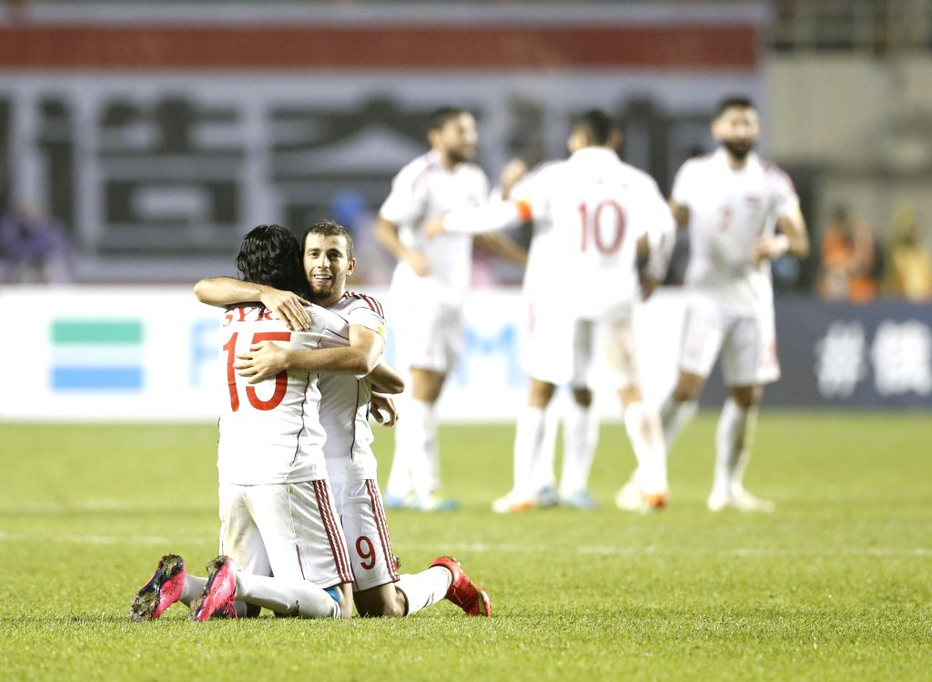 XI'Syria's Mahmoud Almawas (R, front) celebrates after scoring in a match between China and Syria of 2018 FIFA World Cup Russia Qualifiers in Xi'an, capital of northwest ...