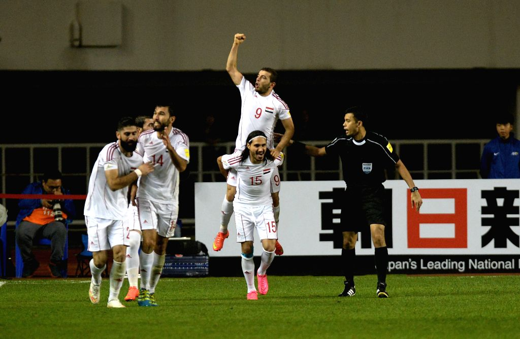 XI'Syria's players celebrate after scoring in a match between China and Syria of 2018 FIFA World Cup Russia Qualifiers in Xi'an, capital of northwest China's Shaanxi ...