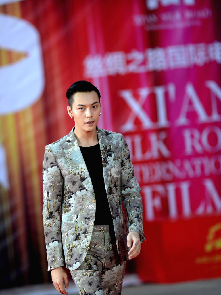XI'William Chan attends the closing ceremony of the 3rd Xi'an Silk Road International Film Festival in Xi'an, northwest China's Shaanxi Province, Sept. 23, 2016.