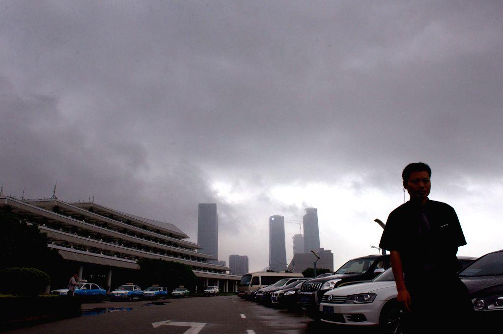 Dark clouds cover the sky in Xiamen, southeast China's Fujian Province, June 16, 2014. The typhoon Hagibis brought torrential rain to Xiamen on Monday. (Xinhua/Jiang