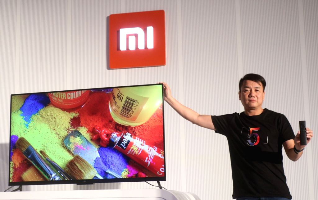 """Xiaomi Global Head Mi TV Wang Chuan during the launch of smart LED TV called """"Mi TV 4"""" in New Delhi on Feb 14, 2018. Xiaomi also launched Redmi Note 5 and Note 5 Pro smartphones."""