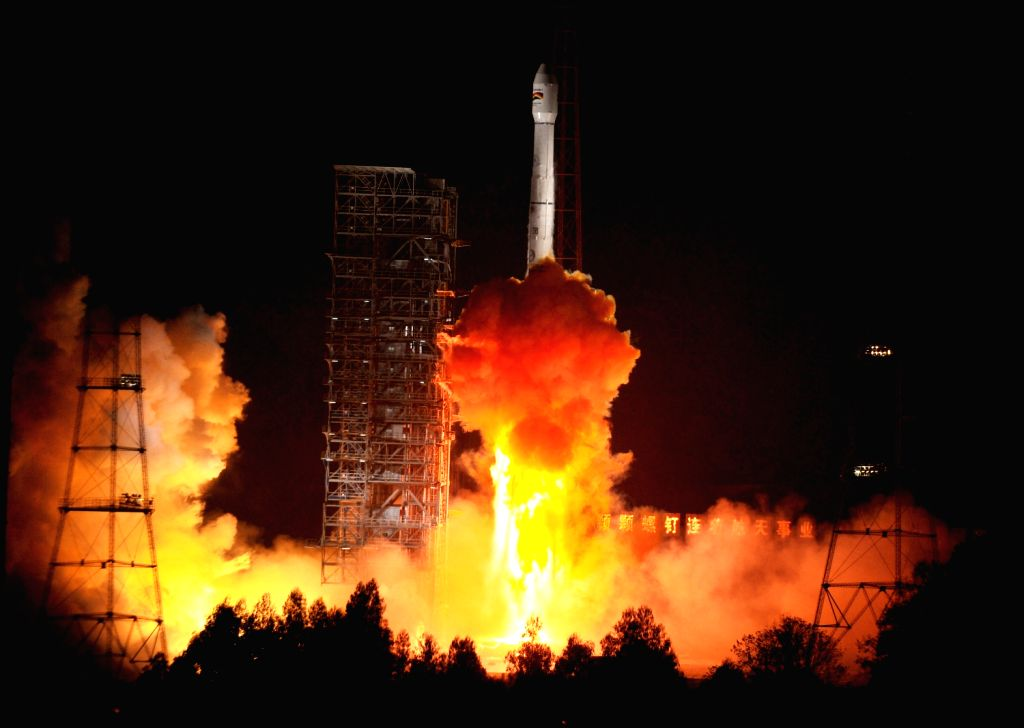 A Bolivian communications satellite is launched from the Xichang Satellite Launch Center(XSLC), southwest China's Sichuan Province, Dec. 21, 2013. China ..