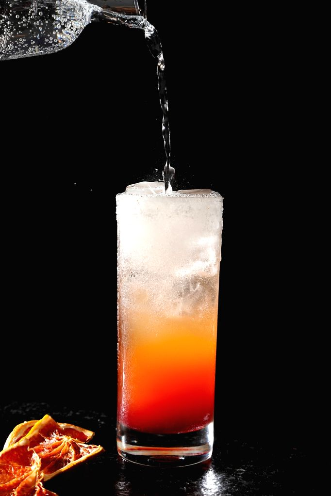 Xico Paloma: The perfect blend of Bacardi, Tequila, Lime Juice, Grapefruit Rosemary syrup topped with Soda.