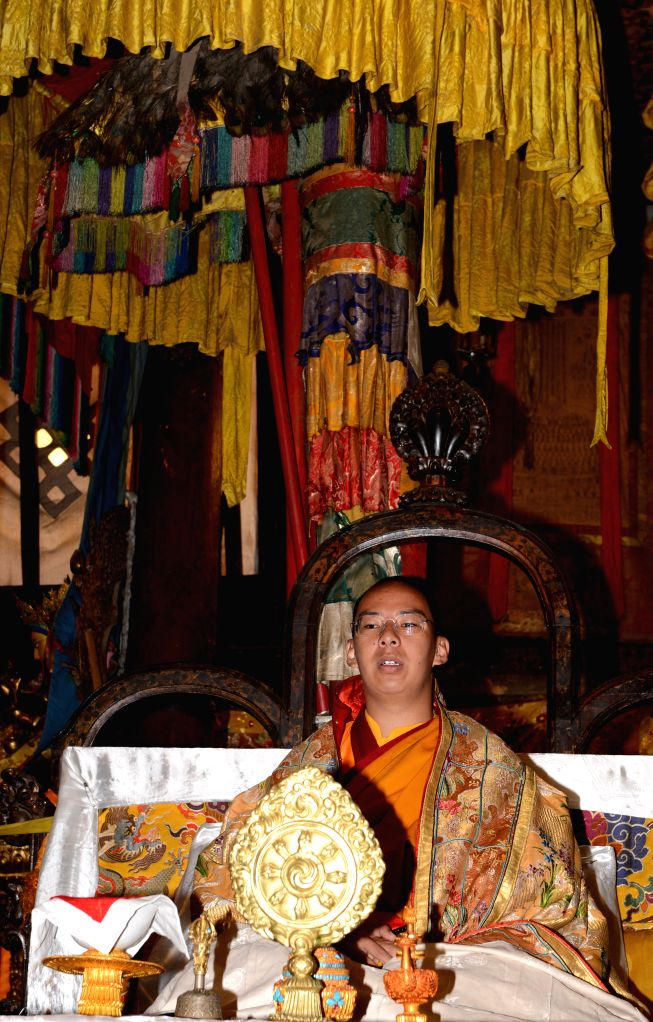 The 11th Panchen Lama, Bainqen Erdini Qoigyijabu, attends a religious ceremony to pray for the victims and survivors in quake-hit Yunnan Province, at the Tashihunpo ..