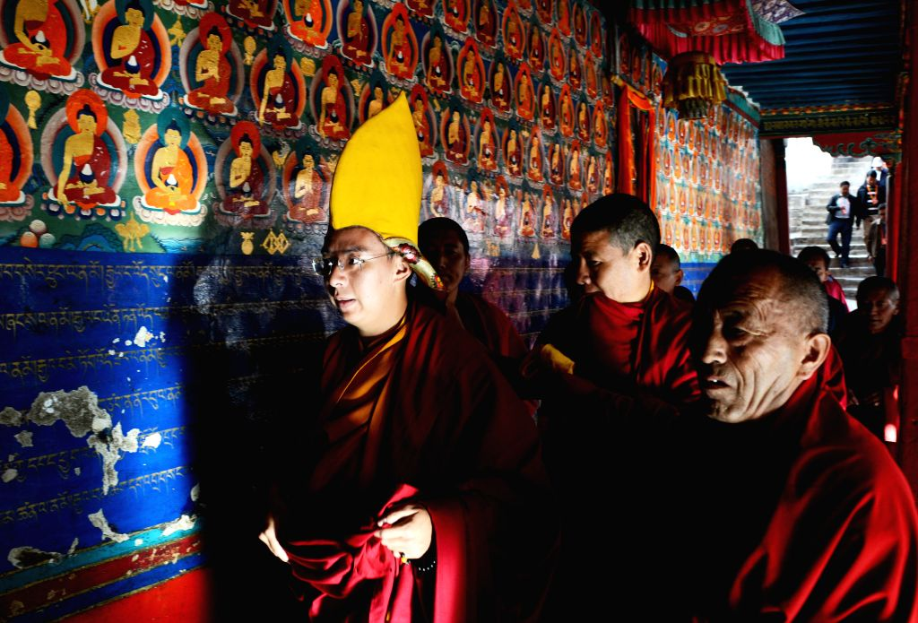 The 11th Panchen Lama (L), Bainqen Erdini Qoigyijabu, attends a religious ceremony to pray for the victims and survivors in quake-hit Yunnan Province, at the ...