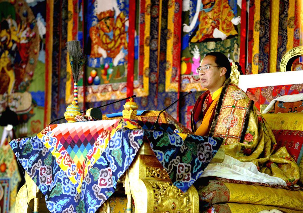 XIGAZE, July 5, 2016 - The 11th Panchen Lama, Bainqen Erdini Qoigyijabu, recites and explains Buddhist scriptures for monks and pilgrims at the Zhaxi Lhunbo Lamasery in Xigaze, southwest China's ...