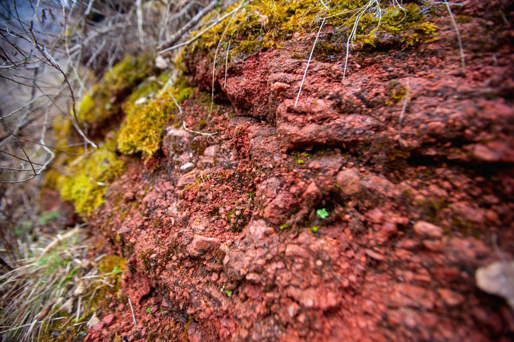 Photo taken on April 17, 2014 shows the red sandstone landscape inside the Huoshanzhai National Geopark in Xiji County of Guyuan, northwest China's Ningxia Hui