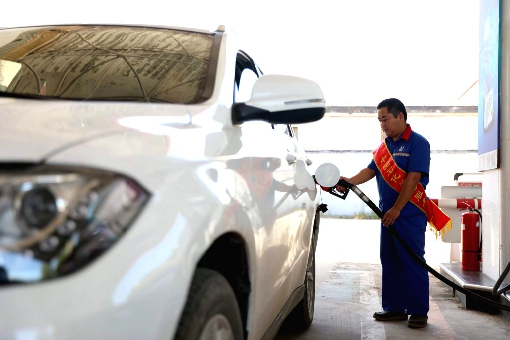 XINGTAI, Sept. 3, 2018 - An employee fuels a vehicle at a gas station in Renxian County, north China's Hebei Province, Sept. 3, 2018. China will raise the retail prices of gasoline and diesel ...