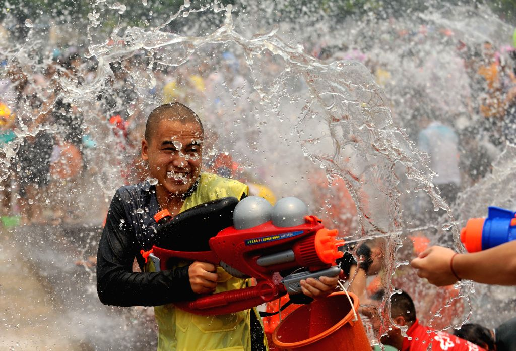 People have fun with water during the Water-splashing Festival in Jinghong City of Dai Autonomous Prefecture of Xishuangbanna, southwest China's Yunnan ...